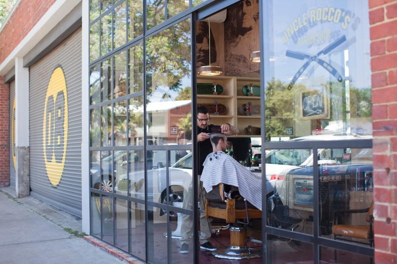 & when you've had your fill of burgers, coffee & skateboards, you can always pop in next door for a wicked hipster haircut at uncle rocco's