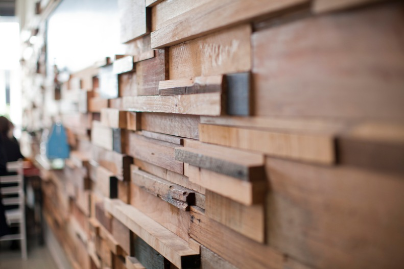 outfitted w/ lovely, recycled timber off-cuts & furniture foraged from flea markets