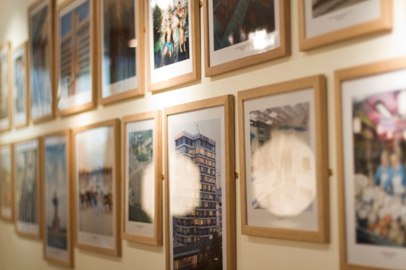 while the walls upstairs are minimally lined w/ monocle mags, inspiring photos in modest frames fill the area down below