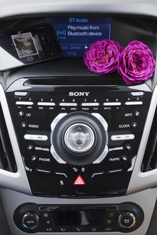 ford's sync system (developed w/ microsoft): delivers voice-recognition control & usb/bluetooth/ipod/aux-compatiblility for your phone & music