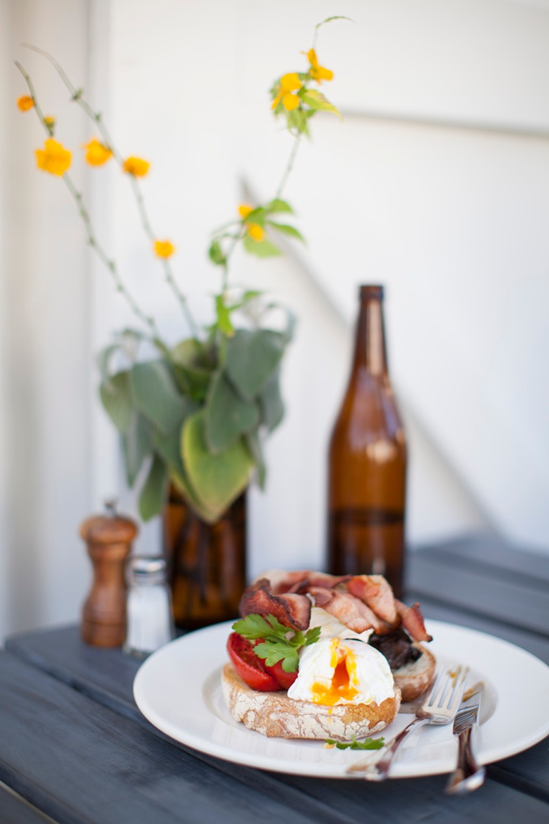 'gardeners' breakfast - the big breakfast of poached eggs, bacon, slow roasted tomato, avocado + thyme buttered mushies