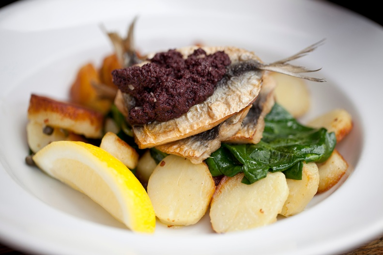 pan fried sardines w/ kipfler potatoes, spinach, capers & tapenade