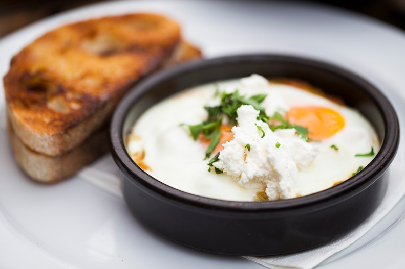 baked eggs w/ eggplant kasundi relish, feta & parsley