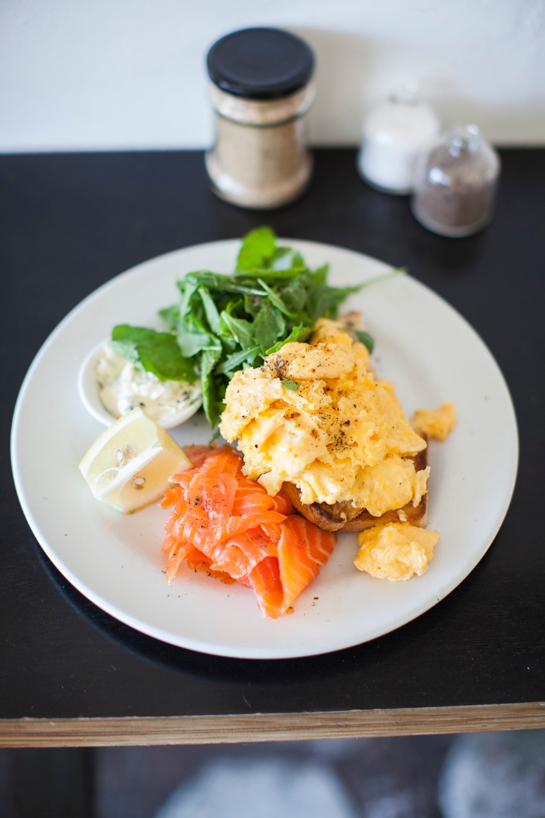 scrambled eggs on sourdough w/ smoked trout, dill creme fraiche & herbed rocket salad