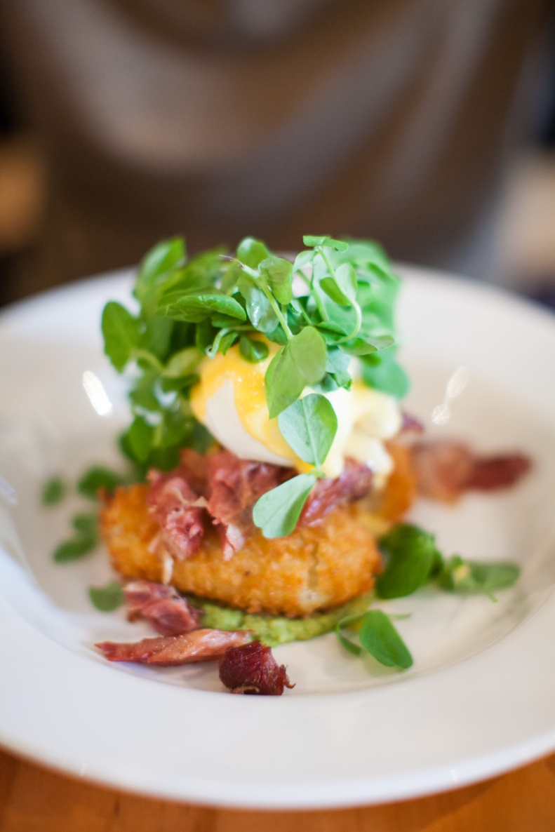 taleggio croquettes w/ shredded ham hock, poached eggs, pea puree, pea foliage & apple cider hollandaise